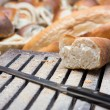 Cutting bread loaf — Stock Photo #12852978