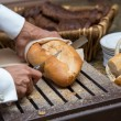 Cutting bread loaf  — Stock Photo