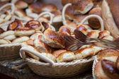 Fresh pies in a bin — Stock Photo