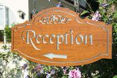 Hotel reception pointer — Stock Photo