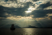 Sailing ship under a cloudy sky — Stock Photo