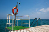 Shower on a pier — Stock Photo