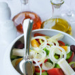 Version of greek salad (with eggs) - Stock Photo