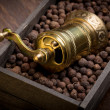 Metal pepper mill in wooden box with pepper — Stok fotoğraf