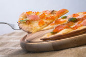 Slice of pizza with caviar and salmon — Stock Photo