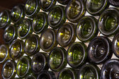 Wine bottles in a cellar — Stock Photo