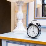 Black vintage alarm clock — Stock Photo