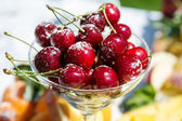 Fresh sweet cherry with sugar powder — Stock Photo