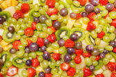 Bright fruit salad background — Stock Photo