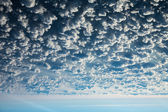 Clouds head over heels — Stock Photo