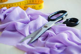 Scissors and a fabric — Stock Photo