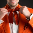 Stock Photo: Mwearing orange bow tie