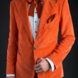 Stock Photo: Orange suit orange bow tie