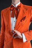 Orange suit orange bow tie — Stock Photo