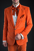Orange suit orange bow tie — Stock Photo