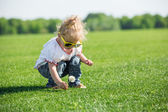 Little girl on a grass — Stock Photo