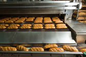 Hot baked breads on a line — Stock Photo