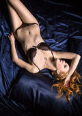 Seductive red-hair girl in a bed — Stock Photo