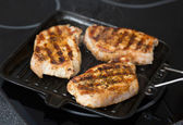 Pork steaks on a grill pan — Stock Photo