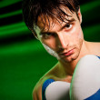 Boxing. Man in boxing gloves — Stock Photo #1189338