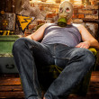 Man in a gas mask - Stock Photo