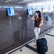 Woman calling on the phone at the airport — Foto Stock
