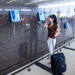 Woman calling on the phone at the airport — 图库照片