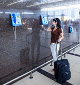 Woman calling on the phone at the airport — Stock Photo