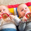 Babies eating from bottle — Stock Photo