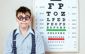 Person wearing spectacles in an office at the doctor — Stock Photo