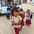 THANJAVUR, INDIA - FEBRUARY 14: School children get off the bus - ストック写真