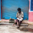 THANJAVUR, INDIA - FEBRUARY 14: Beggar sitting on a street — Stock Photo