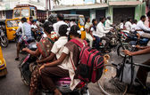 Indian riders ride motorbikes on busy road — Stock Photo