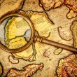 Vintage magnifying glass lies on the ancient map of the North Po - Stock Photo
