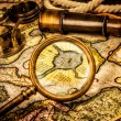 Vintage magnifying glass lies on the ancient map of the North Po — Stock Photo