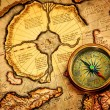 Vintage compass lies on an ancient map of the North Pole. — Stock Photo #22953210