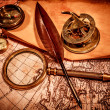 Stock Photo: Vintage magnifying glass lies on ancient world map