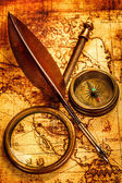 Vintage items on ancient map. — Stock Photo
