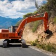 Excavator repair the road. - Stock Photo