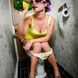 Girl sits in a toilet — Stock Photo