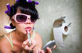 Girl in the toilet — Stock Photo
