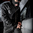 Car thief in a mask. — Stock Photo #25929169