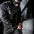 Car thief in a mask. — Stock Photo