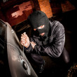 Royalty-Free Stock Photo: Car thief in a mask.