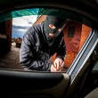 Car thief in a mask. — Stock Photo #25930473
