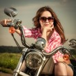 Biker girl sitting on motorcycle — Stock Photo