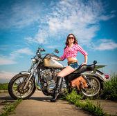 Biker girl sitting on motorcycle — Stock Photo