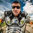 Biker racing on the road — Stock fotografie
