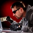 Hacker with laptop — Stock Photo