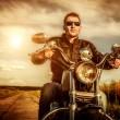 Stock Photo: Biker on a motorcycle